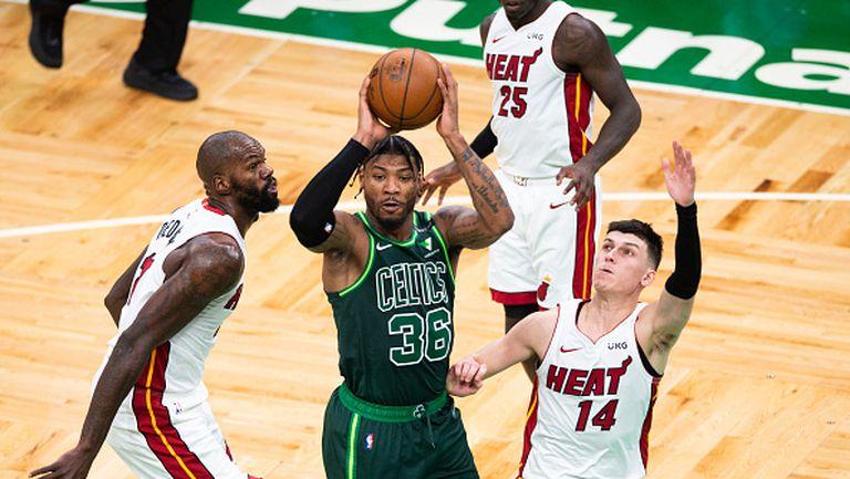 Маями победи Бостън със 129:121 и се класира за плейофите в НБА